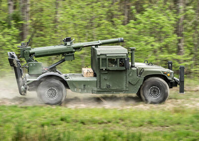 105mm howitzer on an AM General HMMWV.